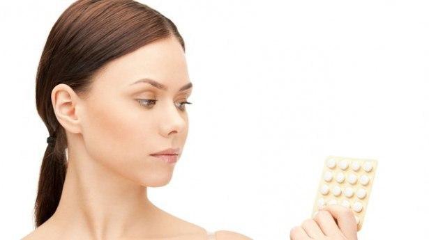 Почему перед месячными болит голова: причины и лечение