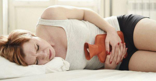 За неделю до месячных болит живот: норма или патология